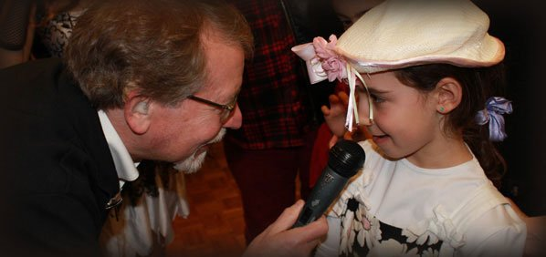 Bill Steinberg talking to smiling girl at Purim