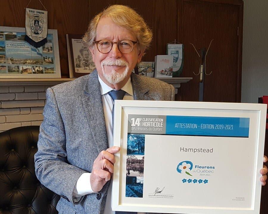 Bill Steinberg holding the award for 5 fleurons for Hampstead