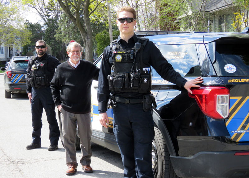 Hampstead Public Security standing in front of their vehicles with the Mayor