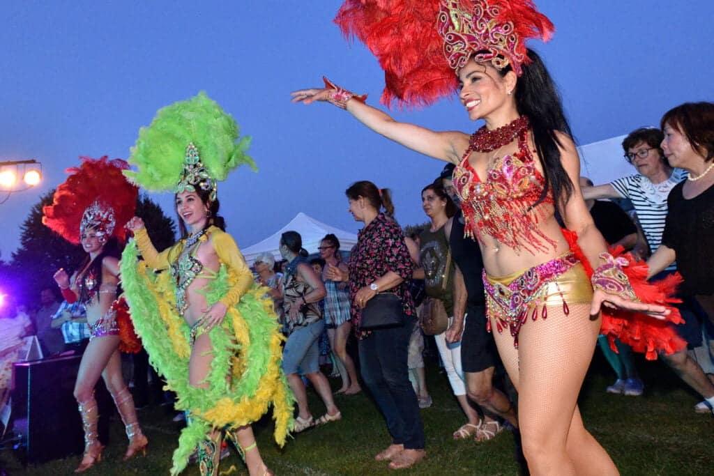 Latin Dancers dancing at an outdoor concert